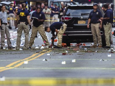 FBI carry on investigations at the scene of Saturday's explosion
