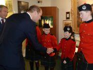 The Duke of Cambridge meets children from The Queen Victoria Schools
