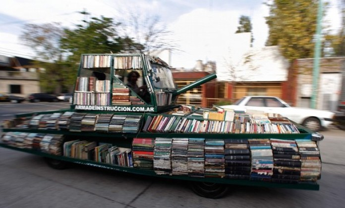 """Artist Raul Lemesoff drives his vehicle called """"Arma de Instruccion Masiva"""" (weapon of mass instruction) through the streets of Buenos Aires"""