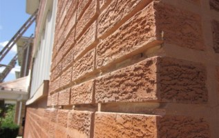 Chicago's Tough Winters Loosen, Make Mortar Fall from Brick Wall Surfaces 3