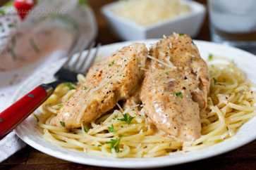 Pressure Cooker Chicken Lazone is seasoned chicken strips fried in butter, pressure cooked until tender, served over pasta in a decadent cream sauce.