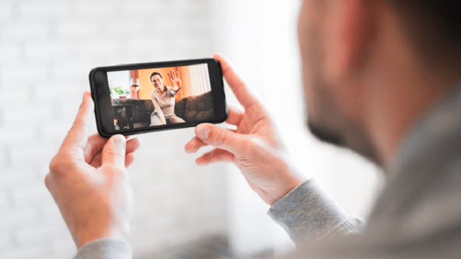 socialising during social distancing on a video call on a smart phone
