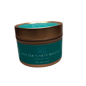 rose gold tin with teal label