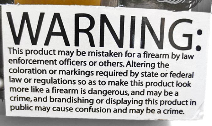 Warning lable on plastic toy guns