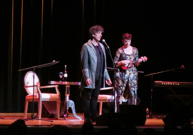 Amanda Palmer performing with ukelele and Neil Gaiman Town hall