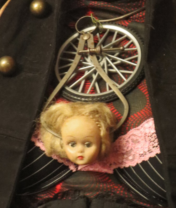 baby head doll necklace
