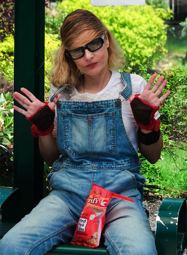 fashion blogger in overalls in Marni fall 2014 hair style