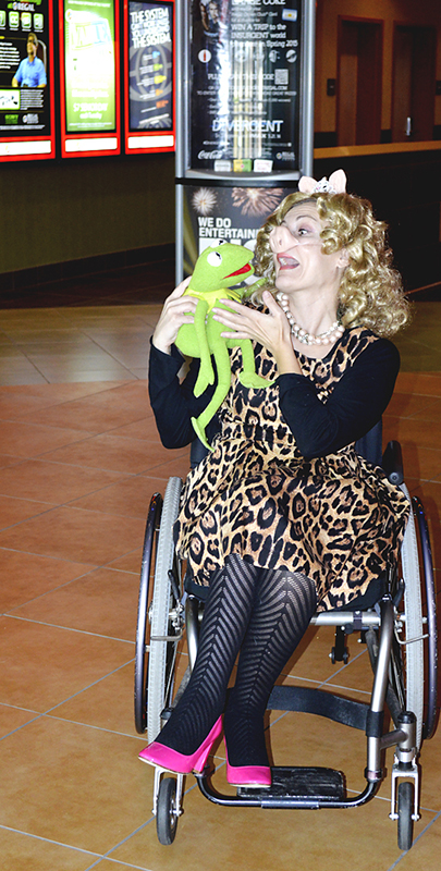 Miss Piggy fan dressed up with kermit