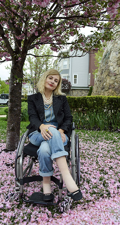 Wheelchair disabled street style wearing overalls