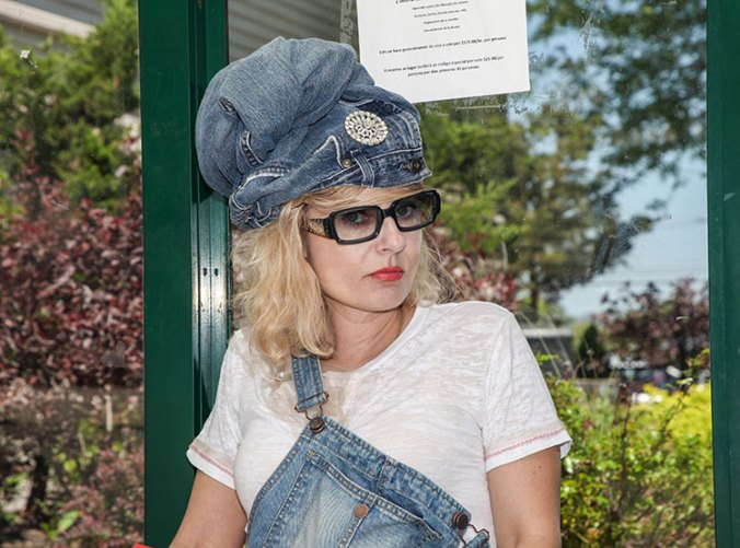 wearing a jean urban turban at a bus stop with overalls