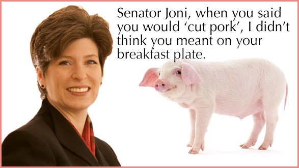 Senator Joni Ernst with pig ready to be eaten