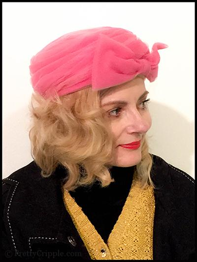 Fashion blogger in pink chiffon pill box hat with huge bow
