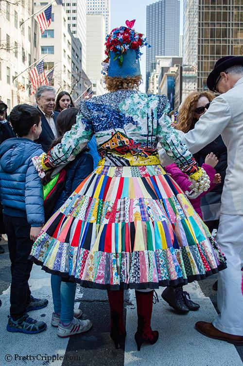 Lady with sequin jacket and patchwork dress easter hat parade nyc