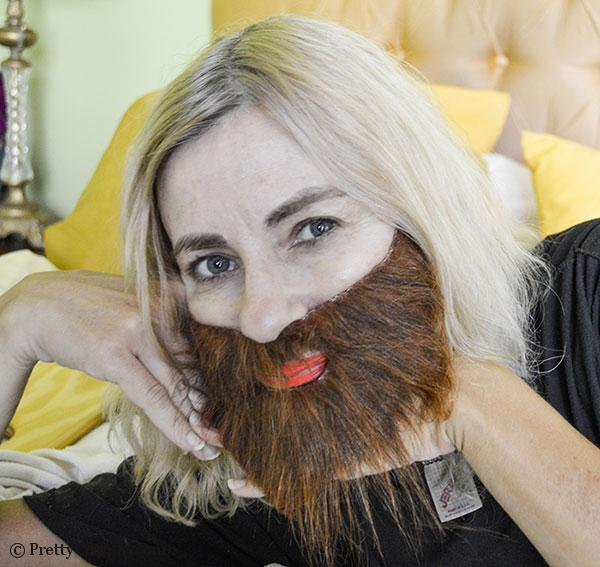 woman with beard trying to act seductive and pretty