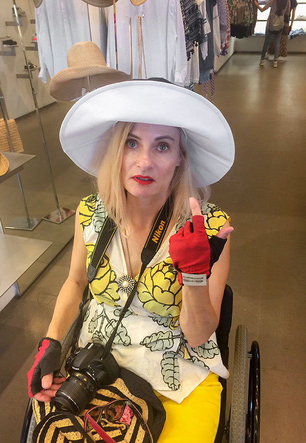 Wheelchair fashion blogger in Scoop NYC sun hat - Meatpacking district