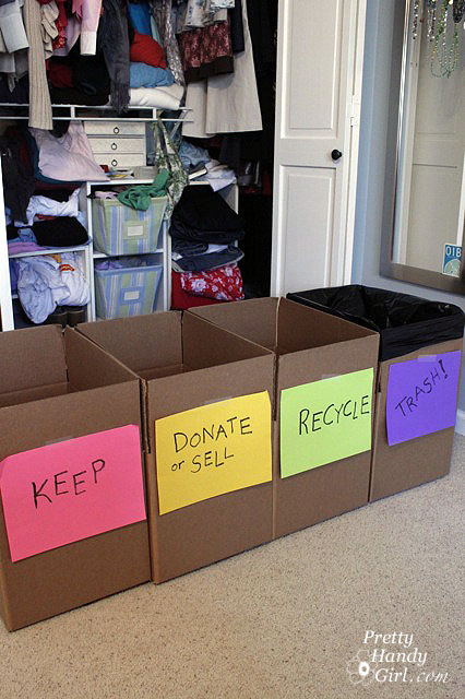 cardboard boxes in front of closet labeled keep, donate/sell, recycle, trash