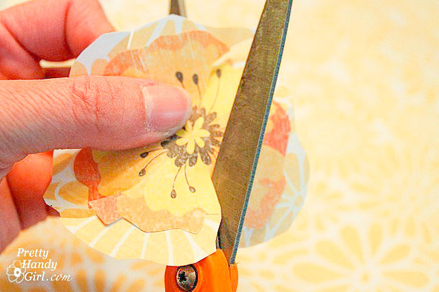 cut slits into both scrapbook flower layers