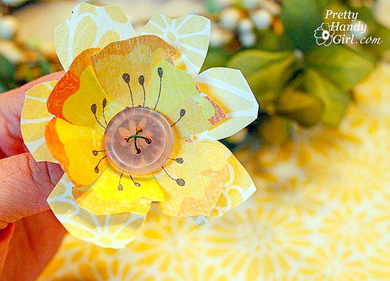 button scrapbook flower made