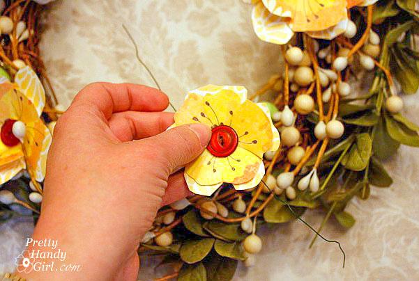 add button flower to wreath
