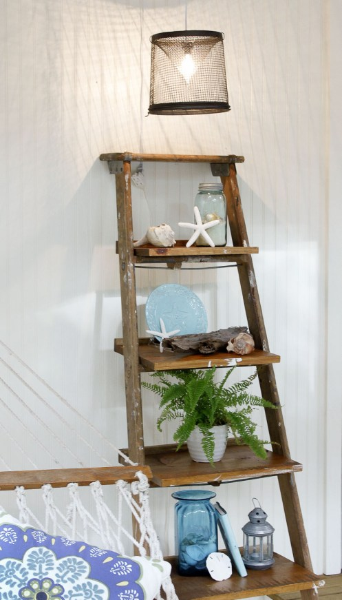 ladder display shelf resting against wall