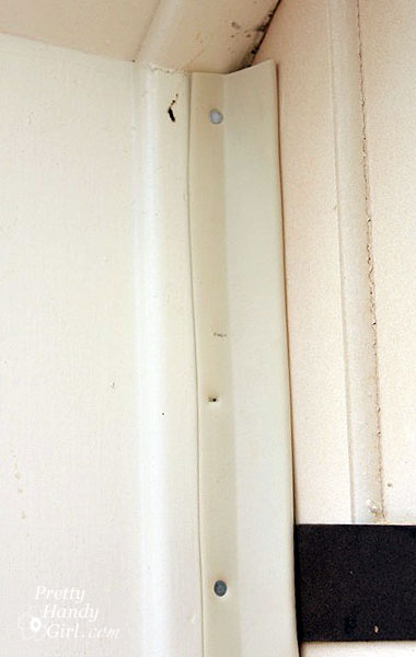 Installing Weatherstripping On A Garage Door Really Warms