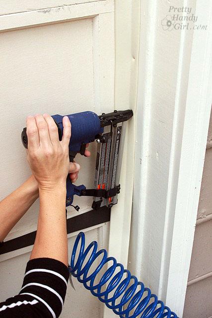 applying weather strip to garage door