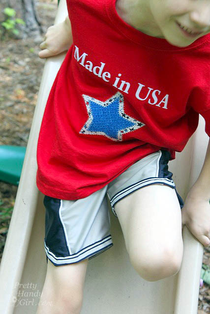 boy_on_slide_red_shirt