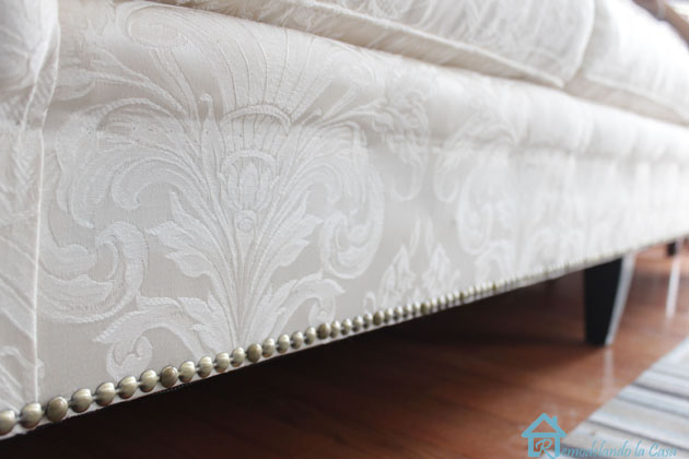 bottom of sofa with nailhead trim