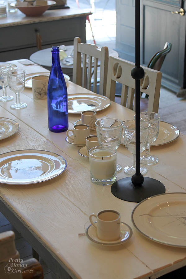 table_set_with_cobalt_bottle