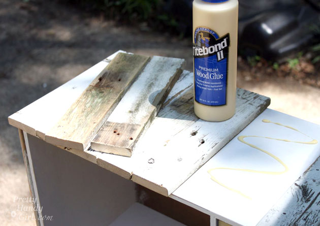 Tite Bond gluing picket pieces to cabinet