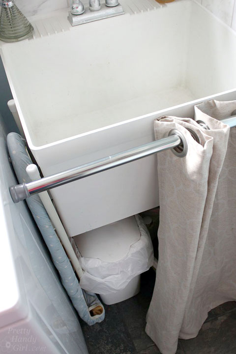 Hidden Storage Under A Laundry Room Sink