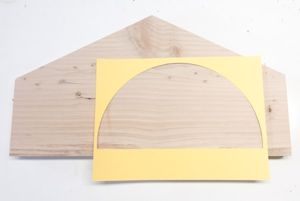 Trade a half circle onto your scrap wood and cut out with a jigsaw.
