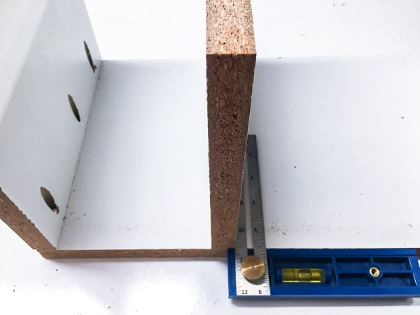 Attach the vertical pieces of the cordless drill storage box with pocket hole screws.