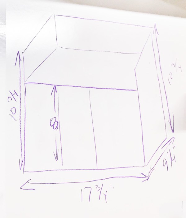 I drew a quick sketch of the cordless drill storage unit on the whiteboard wall of my workshop.