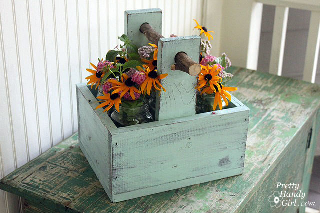 rustic wooden caddy with branch handle