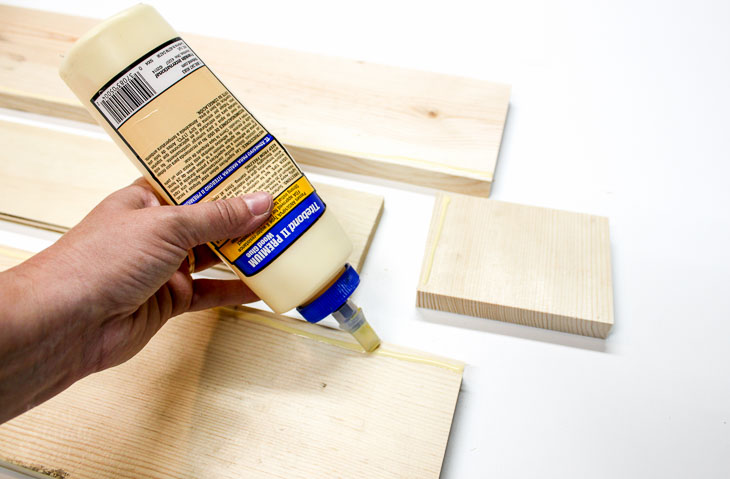 Add wood glue along bottom edges of sides.