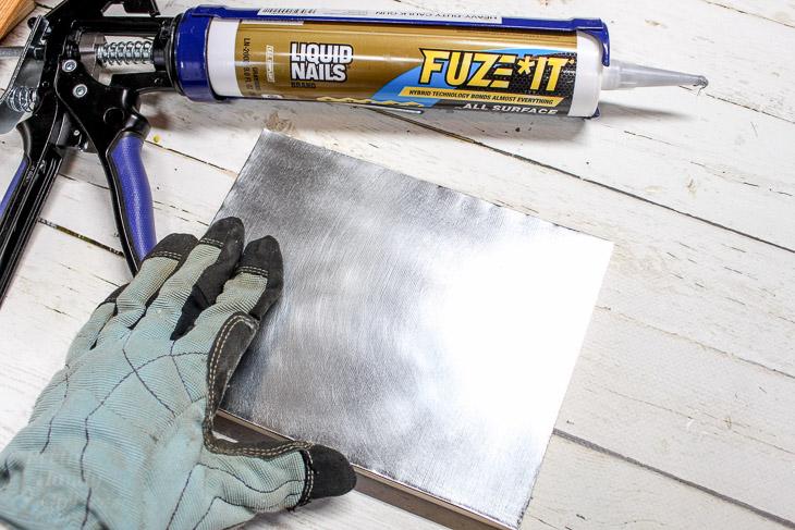 6. Press sheet metal on top of wood base.