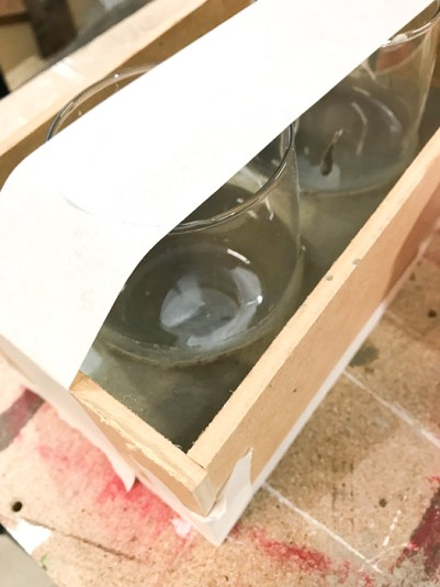 DIY Concrete Desk Organizer - use tape to secure the tumblers in place then pour concrete around them