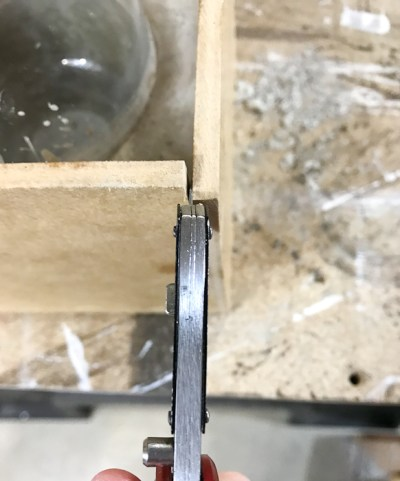 DIY Concrete Desk Organizer- use a knife to pry the wood apart