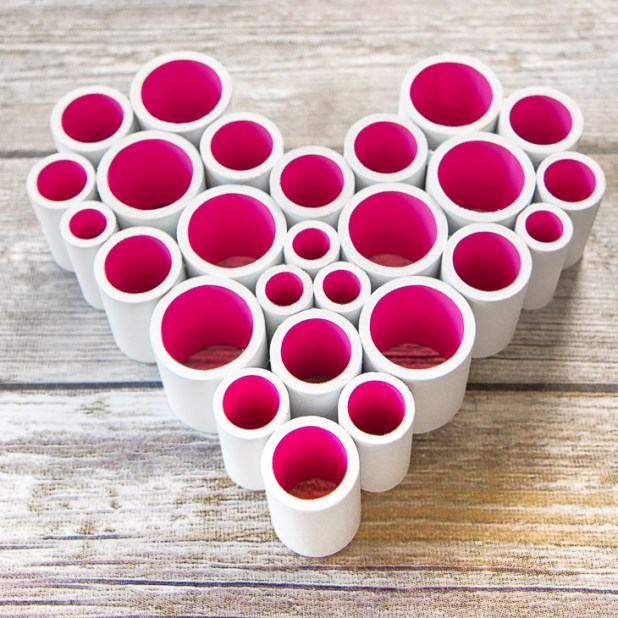 Who knew PVC pipe could look this good? With some paint and hot glue, you can easily make this heart decoration for Valentine's Day!