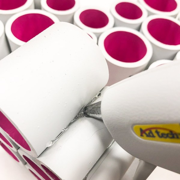 Apply a bead of hot glue to each side of the PVC pipe to form your heart decoration.