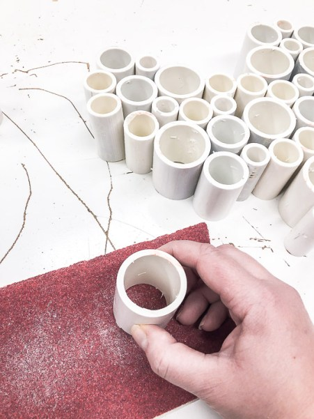 Sand each end of the cut PVC pipe with 80 grit sandpaper.