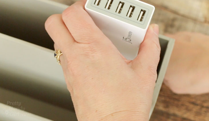 Slide charger into slot and adhere with double sided velcro.