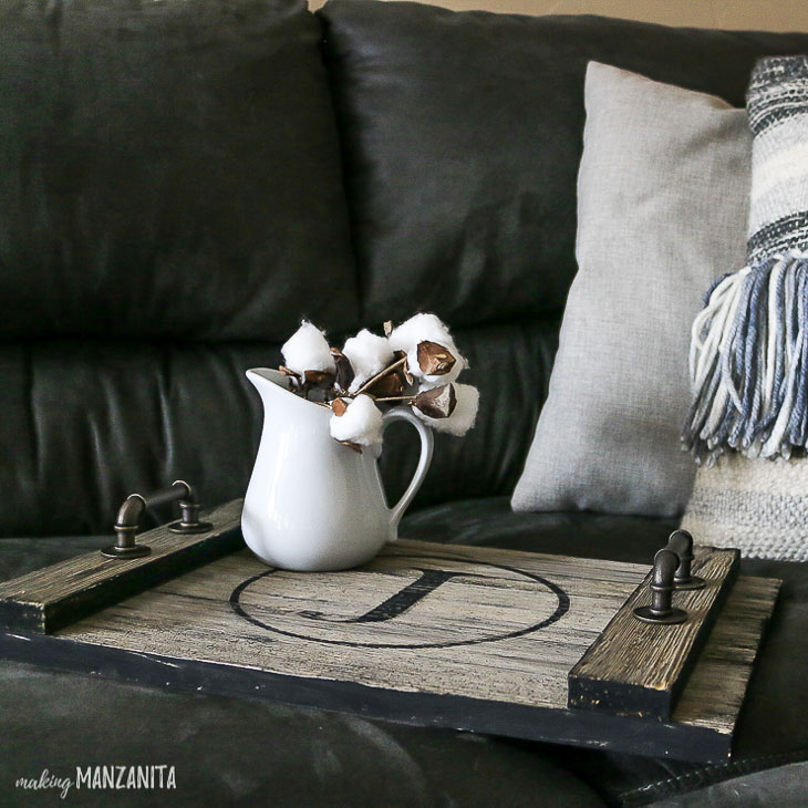 Farmhouse rustic wood serving tray on couch