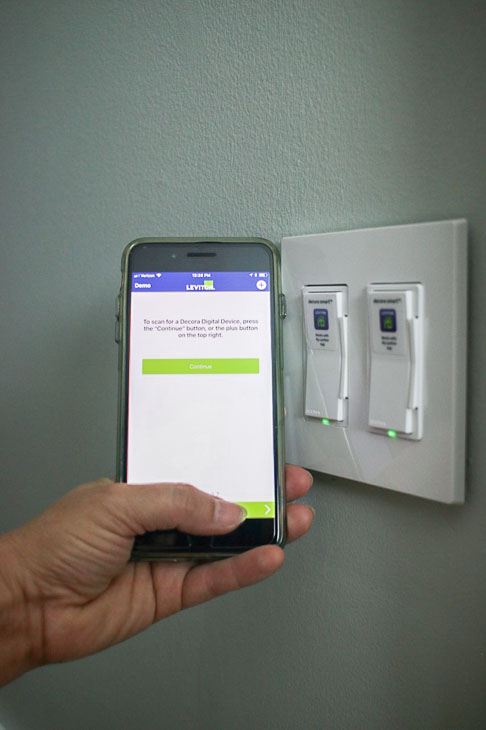 download my leviton app to control lights