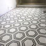 The Builder Depot Carrara Venato Hexagon Nero Strip Marble Mosaic Tile installed on bathroom floor