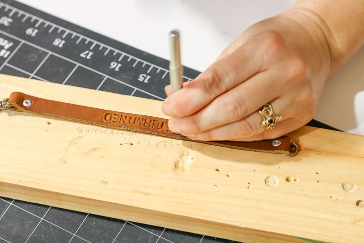 stamping letters into leather