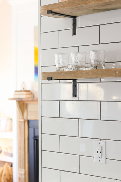 White subway backsplash open reclaimed wood shelving