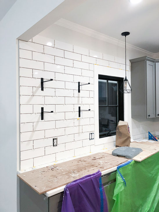subway tile backsplash being installed