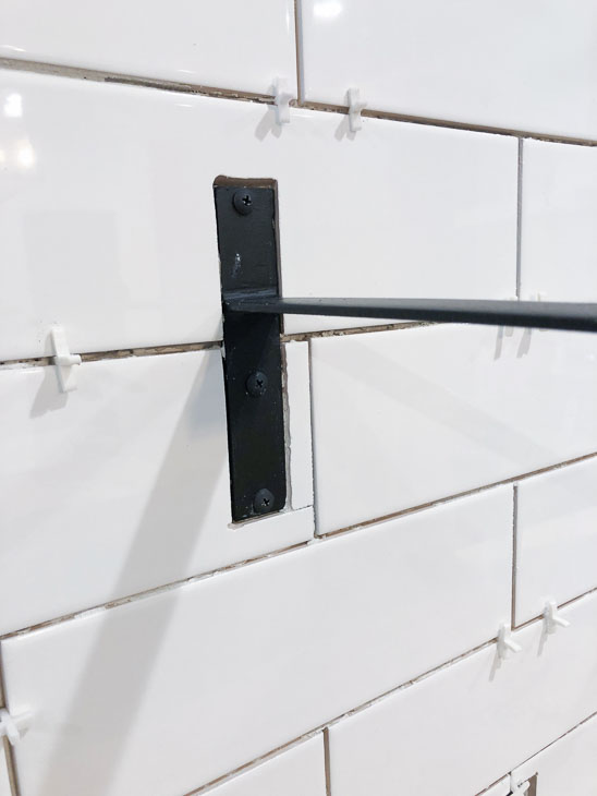 tile around shelf bracket